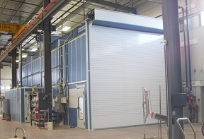 Large automated down draft paint booth.